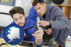 alaska map icon and student studying auto mechanics at a vocational school