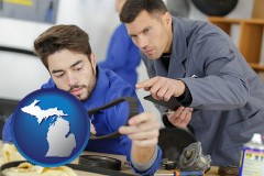 michigan map icon and student studying auto mechanics at a vocational school